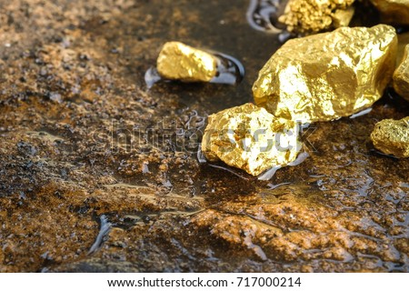 The pure gold ore found in the mine on a stone floor #717000214