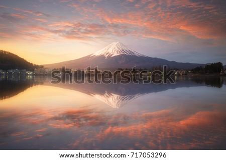 Fuji mountain reflection on water with sunrise landscape,Fuji mountain at kawaguchiko lake, Japan #717053296