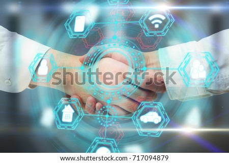 Side view and close up of handshake with abstract digital business network hologram. Teamwork and infograph concept. Double exposure  #717094879