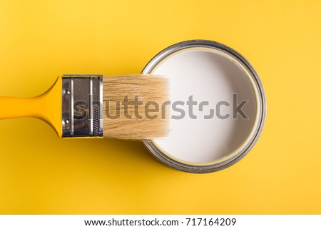 White Paint Can with Brush Top View On Yellow Background. Royalty-Free Stock Photo #717164209