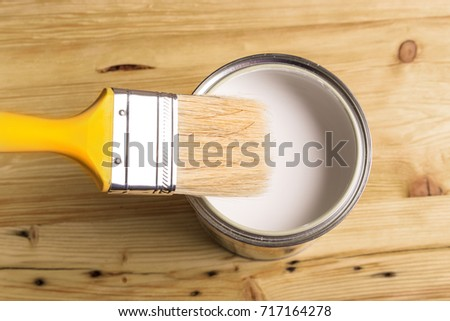 White Paint Can with Brush Top View On Wooden Background. #717164278