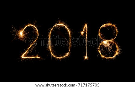 Happy new year 2018 written with Sparkle firework at night #717175705