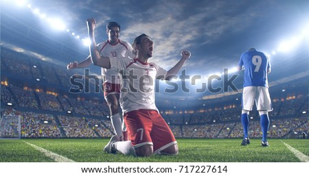 Soccer players celebrate a victory during a soccer game on a professional outdoor soccer stadium. They wear unbranded soccer uniform. Stadium and crowd are made in 3D. #717227614
