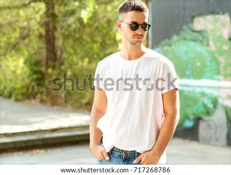 fashion guy posing at sunset in the park #717268786