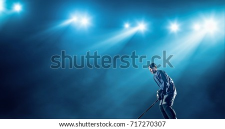 Ice Hockey player is skating on a abstract background with intensional lens flares. He is wearing unbranded sports clothes. #717270307