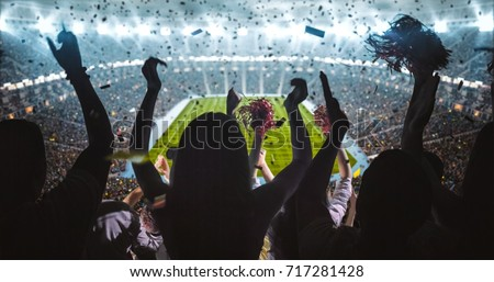 Group of fans are cheering for their team victory Royalty-Free Stock Photo #717281428