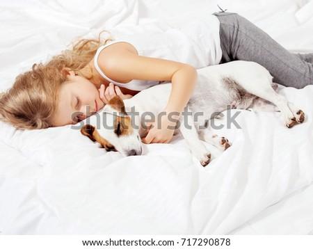 Sleeping child with dog #717290878