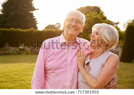 Senior couple in garden smiling to camera, close up #717301903