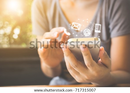 Woman hand using smart phone, Contact us connection concept Royalty-Free Stock Photo #717315007