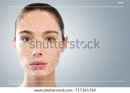 Futuristic and technological scanning of the face of a beautiful woman for facial recognition and scanned person. It can serve to ensure personal safety. Concept of:  future, security, scanning. #717365764