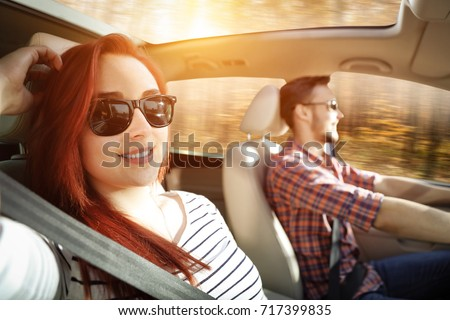 Autumn road and two lovers on trip in car  #717399835