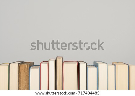 Row of books on a gray background with space for copy #717404485