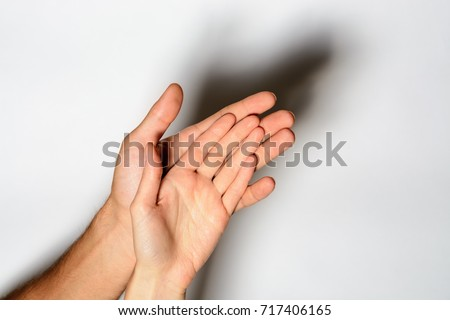 The female hand is the hand of a man. the concept of family, love, care. The man is a pillar of the family. toned #717406165
