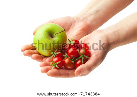 hand holding fresh apple and tomatoes, isolated on white background #71743384