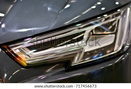Close up view of a car headlight #717456673