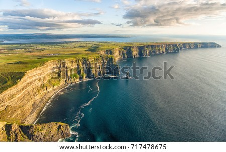 Aerial birds eye drone view from the world famous cliffs of moher in county clare ireland. Scenic Irish rural countryside nature along the wild atlantic way and European Atlantic Geotourism Route  #717478675