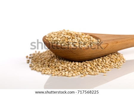 Pile of grain quinoa seeds in spoon isolated over the white background #717568225