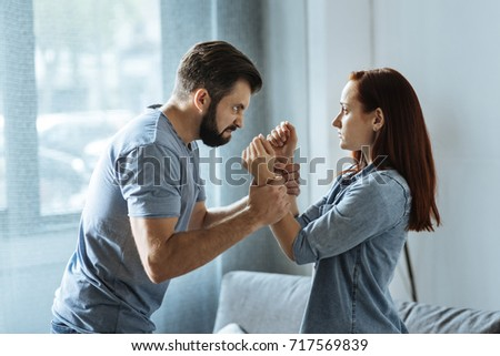 Angry strong man losing control over his emotions #717569839