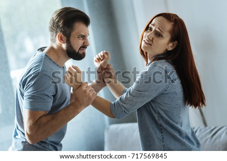 Strong brutal man holding his wife #717569845