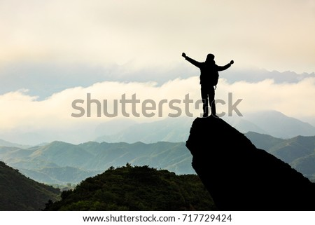 Silhouette of the man success on the peak of mountain,Sport and active life #717729424