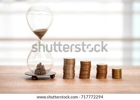Deadline and time is money concept with hourglass #717772294