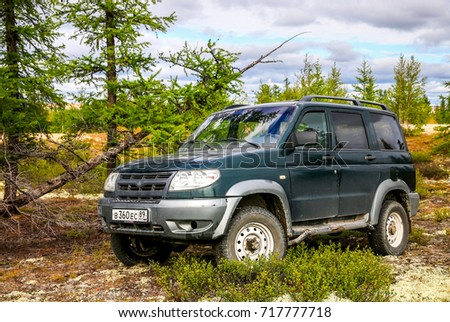 NOVYY URENGOY, RUSSIA - AUGUST 12, 2017: Off-road car UAZ 3163 Patriot at the countryside. #717777718