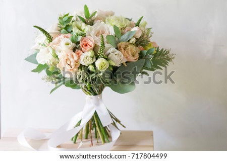 Bridal bouquet. A simple bouquet of flowers and greens Royalty-Free Stock Photo #717804499