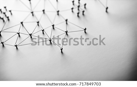 Linking entities. Monotone. Networking, social media, SNS, internet communication abstract. Small network connected to a larger network. Web of black wires of white background. #717849703
