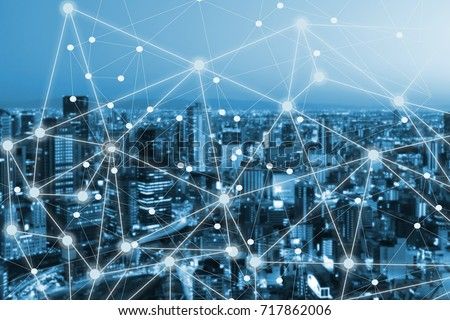 Business and communnication network on city background #717862006