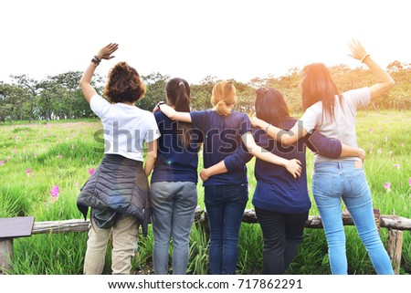 Rear of group woman standing on garden at Sai Thong National Park, Chaiyaphum Province, Thailand. subject is blurred. #717862291