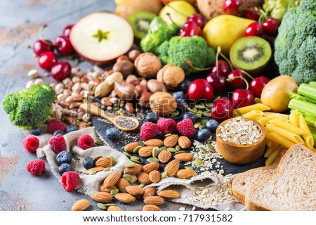 Healthy balanced dieting concept. Selection of rich fiber sources vegan food. Vegetables fruit seeds beans ingredients for cooking Royalty-Free Stock Photo #717931582