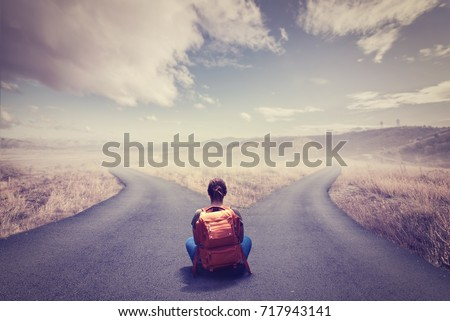 Concept of choice with crossroads spliting in two ways Royalty-Free Stock Photo #717943141