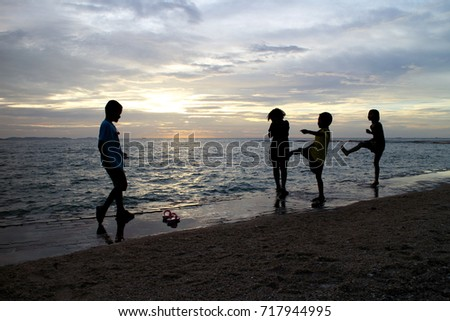 PATTAYA, THAILAND - August 18, 2017: Unidentified children playing on the beach, Pattaya city, Chonburi, Thailand. August 18, 2017 #717944995