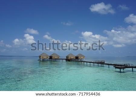 tropical Maldives island with beach #717954436