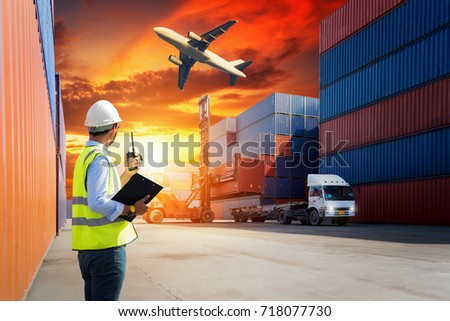 Industrial Container yard with forklift working in shipyard at sunset for Logistic Import Export background #718077730