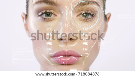 Futuristic and technological scanning of the face of a beautiful woman for facial recognition and scanned person. It can serve to ensure personal safety. Concept of:  future, security, scanning. #718084876