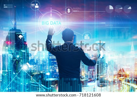 """Back view of a businessman touching """"BIG DATA"""" word on digital virtual screen with both hands. Hi-tech business concept . #718121608"""