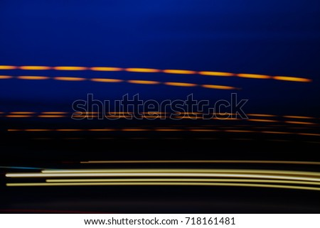 Abstract motion blur of multicolor night light on a black background. #718161481
