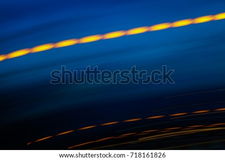 Abstract motion blur of multicolor night light on a black background. #718161826