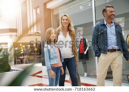 Family on shopping day walking in mall #718163662