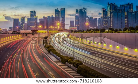 Singapore City highway, Movement of car light with singapore cityscape skyline during sunset, Singapore. #718210108