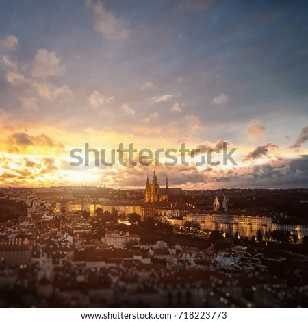 Beautiful aerial sunset view of the Prague city, panoramic view with a castle on the horizon from above. Amazing city landscape #718223773