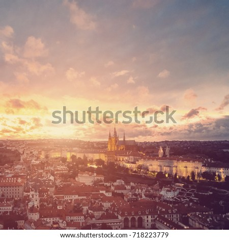 Beautiful aerial sunset view of the Prague city, panoramic view with a castle on the horizon from above. Amazing city landscape #718223779