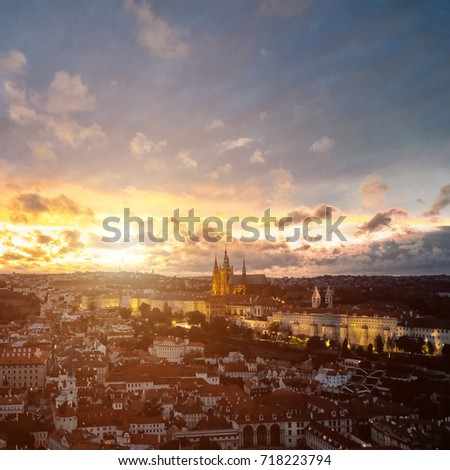 Beautiful aerial sunset view of the Prague city, panoramic view with a castle on the horizon from above. Amazing city landscape #718223794