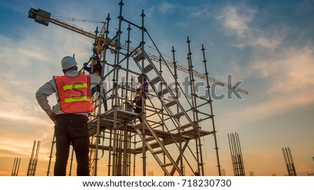 Work Safety officer or Civil Engineer. team worker on background of construction site #718230730