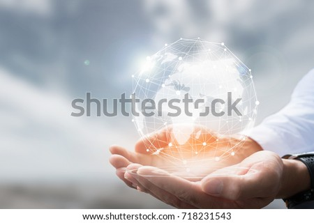 Businessman holding in hand with global connection concept. Royalty-Free Stock Photo #718231543