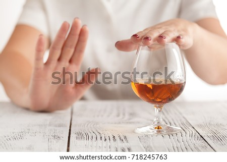 woman refuses to drink a alcohol Royalty-Free Stock Photo #718245763