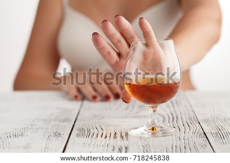 woman refuses to drink a alcohol #718245838