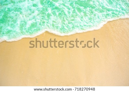 soft wave of blue ocean on sandy beach. background. selective focus. beach and tropical sea white foam on beach. soft focus on bottom of picture. #718270948