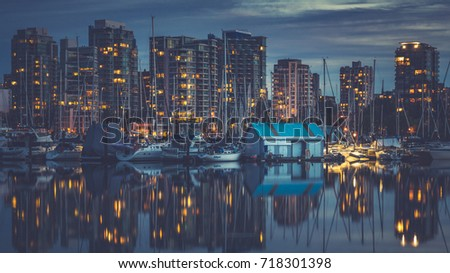 Vancouver British Columbia Canada,September 2017.Vancouver downtown and reflections of Vancouver city at Coal Harbor #718301398